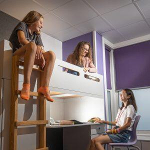 three teenage girls in boarding accommodation at taunton school
