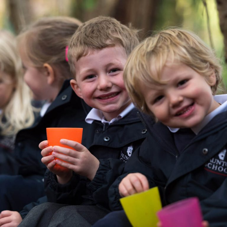 nursery students holding plastic cups