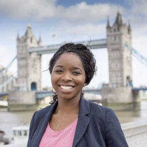 teenage girl smiling in front of london bridge