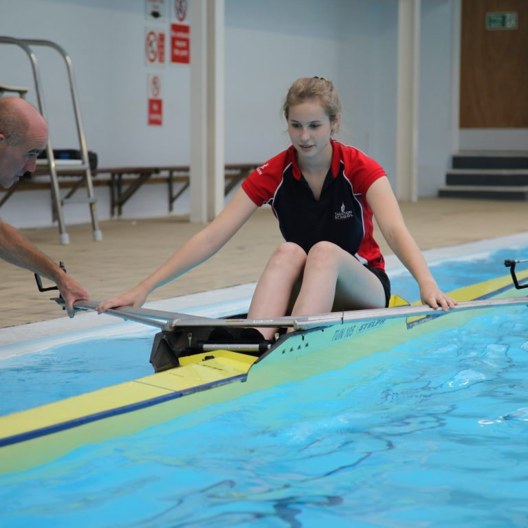 girl having a rowing lesson