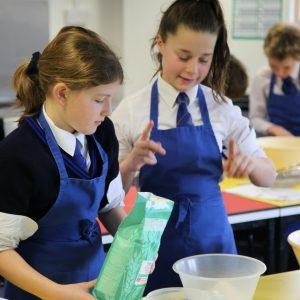 school girls baking
