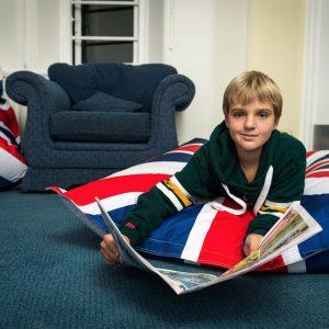 boy reading comic on bean bag