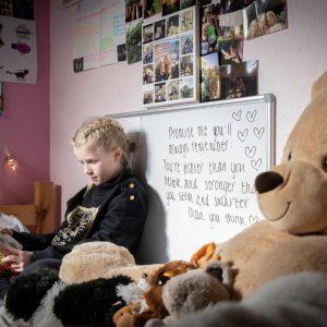 girl reading in bedroom