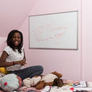 boarding school girl with whiteboard