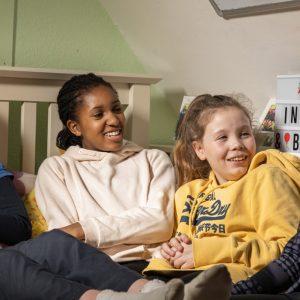 boarding school girls talking in bedroom