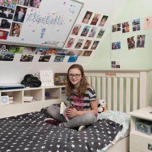 school girl in boarding school bedroom
