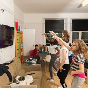 children playing a dancing video game