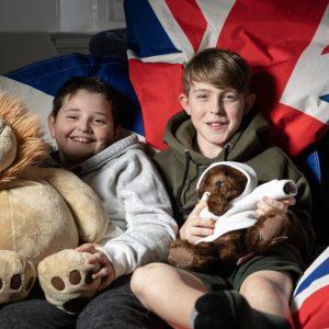 boys cuddling soft toys