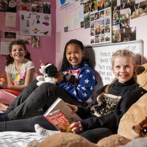 3 girls in boarding school bedroom