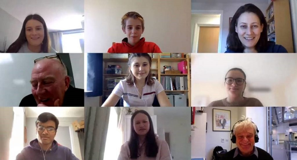students and teachers talking to each other over a video call