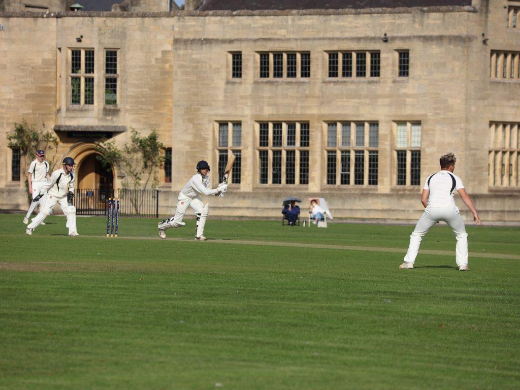 children play cricket