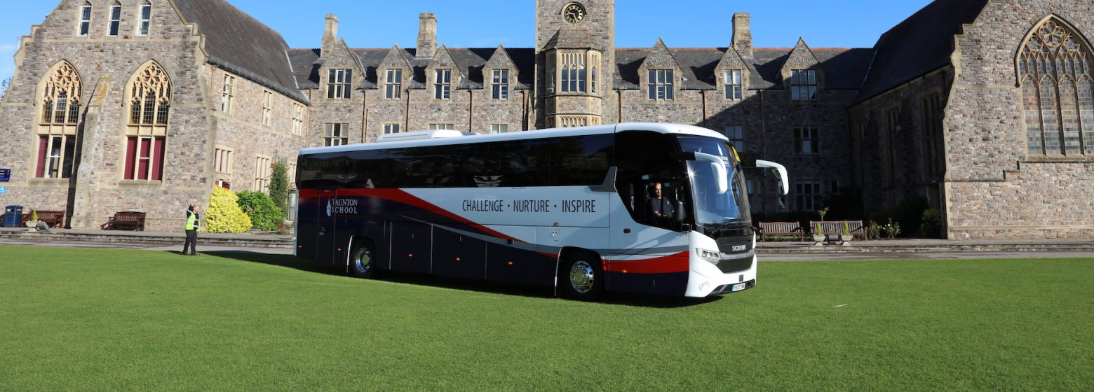 A coach in front of taunton school